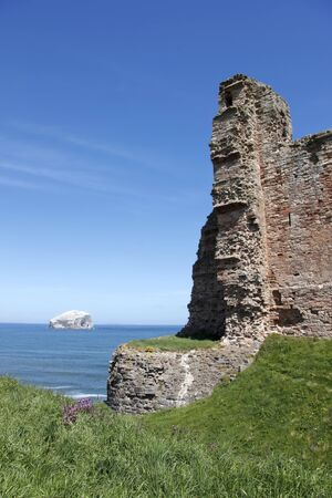 lothian: bass rock seen through the ruins of 14th century tantallon castle at the mouth of the firth of forth in east lothian scotland destroyed in the english civil war in 1651