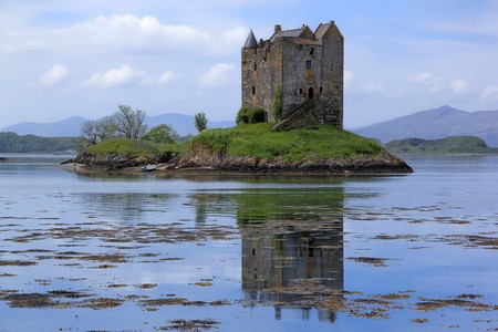 small medieval castle stalker on small island in loch linnhe argyll in the scottish highlands photo