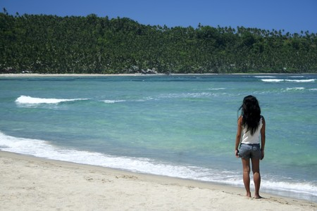 filipina girl standing on remote tropical beach in sorsogon south luzon in the philippines photo