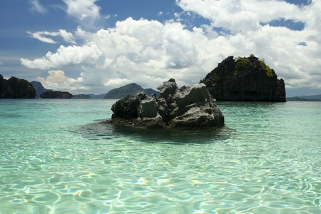 rock formation: karst rock formations rise out of the clear ocean of el nido palawan island in the philippines