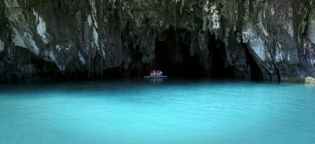 small boat of tourists in the entrance to the underground river in sabang palawan in the philippines Stock Photo - 7978102