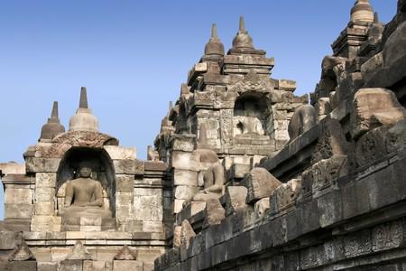 relief carvings on stone walls of borobudur temple ruins yogyakarta java indonesia photo