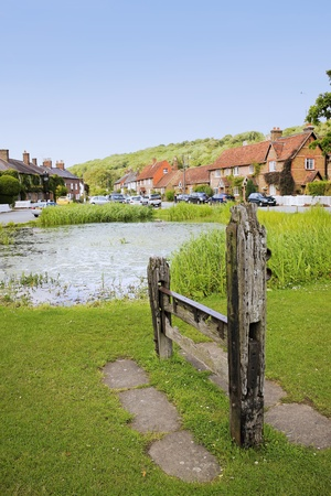 medieval wooden stocks on aldbury village green in hertfordshire england, used as a form of punishment and public humiliation