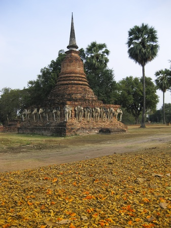 stupa decorated with elephant reliefs in the temple ruins of sukhothai historical park northern thailand photo