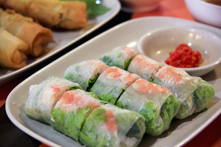 vietnamese summer rolls, fresh spring rolls with prawn and vegetable served with chilli po noodle soup and fried spring rolls served at food court in bangkok thailand