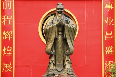 statue of confucius in chinatowns wat traimet bangkok thailand