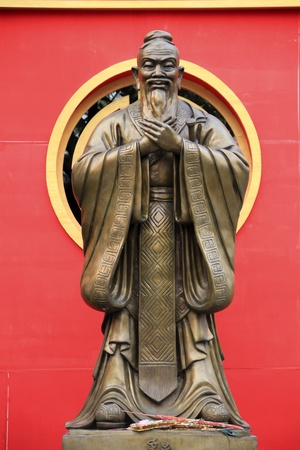 statue of confucius in chinatowns wat traimet bangkok thailand photo