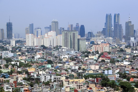 densley populated housing developments crowding high rise condominium ad commercial districts in ortigas and makati manila the philippines Stock Photo