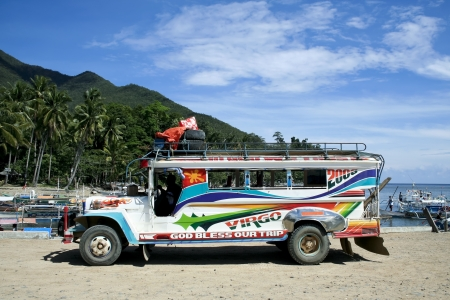 local public transport in the philippines a colorful jeepney parked in sabang port, palawan iland in the philippines Editorial