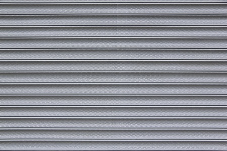 close-up detail of closed metal security shutter photo