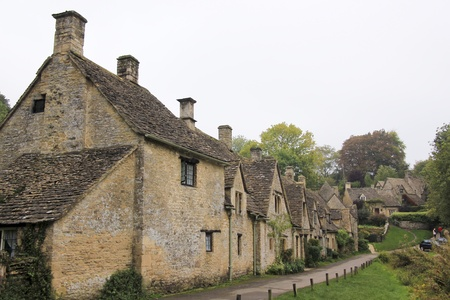 english countryside: Row of traditional cottages built of golden limestone in Bilbury Village, The Cotswalds, Gloucestershire, England