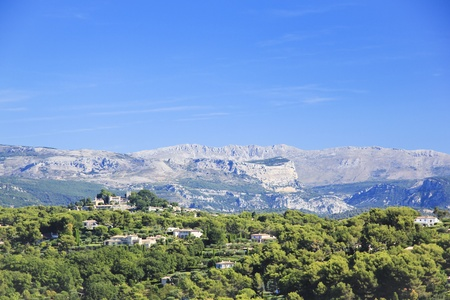 alpes: Whitewashed house and villages on the sides of the hills inland from cannes in the cote dazur in the south of france