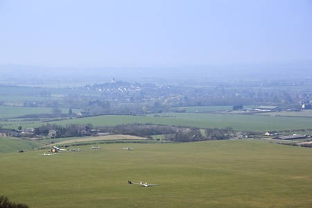 gliders on the dunstable downs in the aylesbury vale buckinghamshire england with Edlesborough village in the distance photo