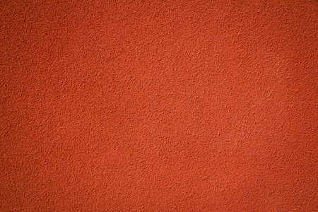 close-up detail of rough red stucco wall finish  photo