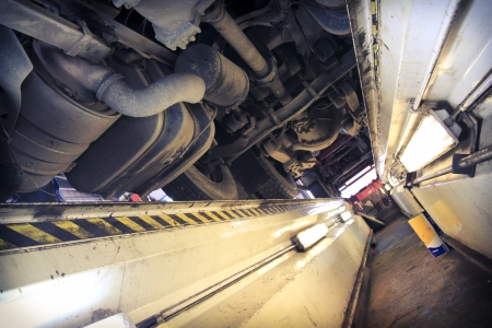 axle: underneath of a truck as seen from vehicle inspection trench