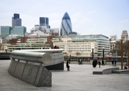 The Gherkin and other financial institutions of the city of london behind the plaza of the town hall  photo
