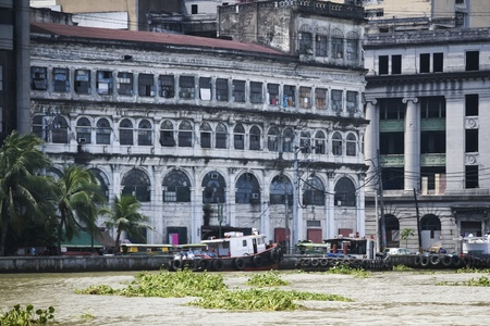 manila: the pasig river flowing past old run down buildings in the centre of manila capital of the philippines Stock Photo