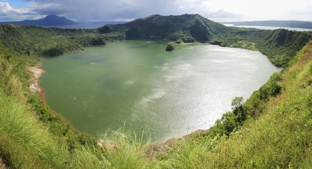 crater lake: taal crater lake seen from the slopes of the highly active taal volcano tagaytay in the philippines