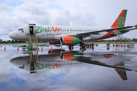 livery: Kalibo Airport, Panay Island, The Philippines - November 11, 2010: Zest Air commercial passenger airliner parked on the runway of Kalibo airport during heavy rain storm before its return flight to manila, Zest air formerly known as Asian Spirit is a budge Editorial