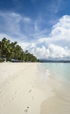 footrpints in the fine sand of white beach on tropical  boracay island in the philippines photo