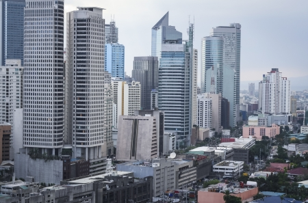 high rise apartment blocks and moden office buildings throng the streets of makati centre of manila in the philippines