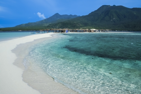 sandbar: volcanic landscape of camiguin island rises above white beach sand spit mindanao the philippines Stock Photo