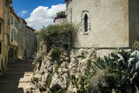 houses line the narrow streets of antibes old town in the french riviera Stock Photo - 16573332
