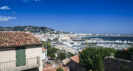 view over cannes town and marina over hillside villas in the cote d'azur in the south of france Stock Photo - 16579098