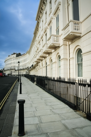 kerb: row of beautiful regency terraced houses on brighton seafront in west sussex in england Stock Photo