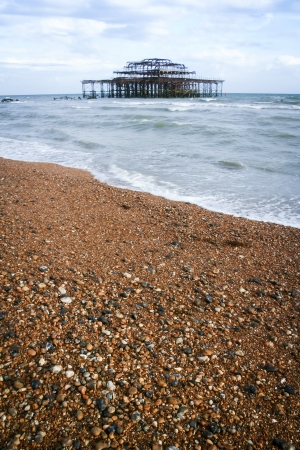 brighton beach: the ruins of the victorian west pier on brighton beach west sussex england Stock Photo