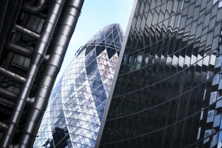 perspective view of street in the city of london financial district with striking modern architecture of the gherkin lloyds and willis buildings