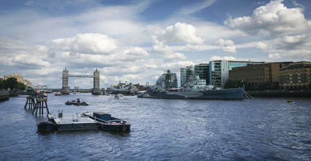 hms belfast world war 2 battleship on the river thames running through london england tower bridge behind photo