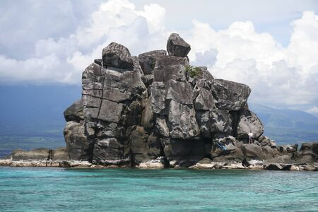 apo: rock formation on apo island beach in the philippines
