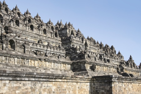 ornately: ornately decorated walls of ancient stone pyramid in borobudur temple complex in yogyakarta, java indonesia