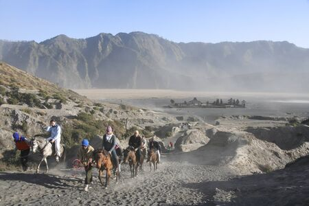 MOUNT BROMO, JAVA, INDONESIA - SEPTEMBER 26: tourists on horses climbing the slopes of mount bromo volcano on September 26 2007 in JAVA.