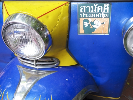 BANGKOK - OCTOBER 24: detail of iconic tuk tuk motorbike taxi  on October 24, 2007  in Bangkok, Thailand.