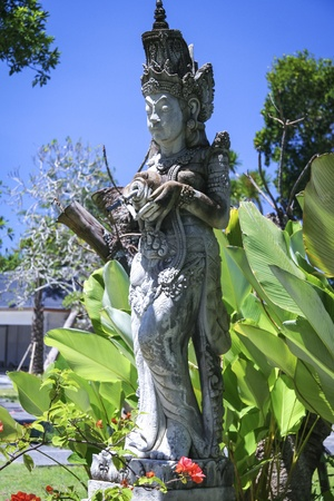 sanur: traditional balinese style statue in temple gardens in sanur bali Stock Photo