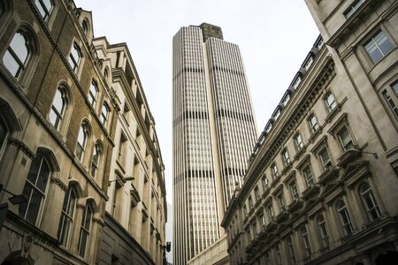 view along street of old fashioned offices towards modern office block in city of london financial centre Stock Photo - 19622752