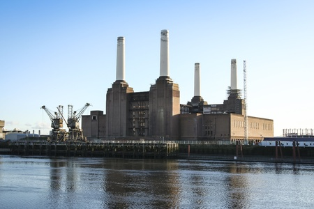 old coal fired victorian power station in battersea london on the bank of the thames photo