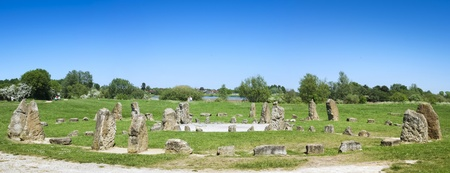 milton: blue sky over stone circle in willen park milton keynes buckinghamshire england
