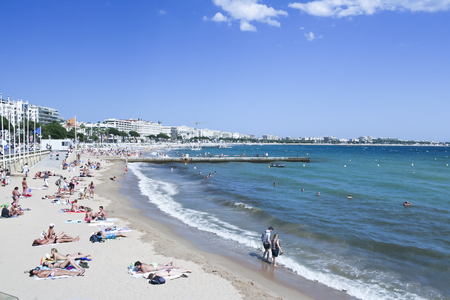 beachfront: Cannes, France - June 2, 2015: People on the most popular public beach in Cannes, France - Plage de la Croisette - Cannes beachfront, considered between 5 best urban beaches of Europe.