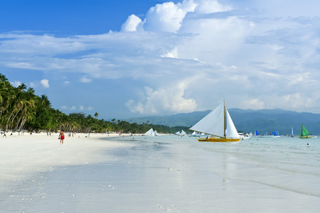outrigger: paraw outrigger sailboats on boracay white beach popular tourist destination in the philippines Stock Photo