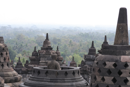 below: view from the top of borobudur temple across the jungle below in yogyakarta java indonesia Stock Photo