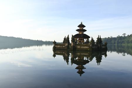 crater lake: dawn at Pura Ulun Danu water temple on lake brataan near bedugal, bali, indonesia