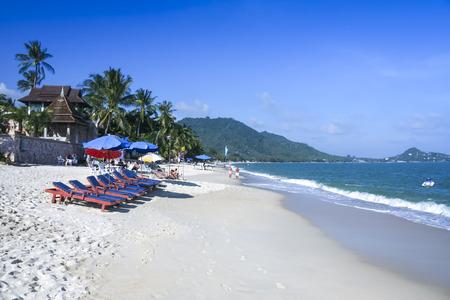 relaxing beach: tourists relaxing on the popular lamai beach ko samui island thailand