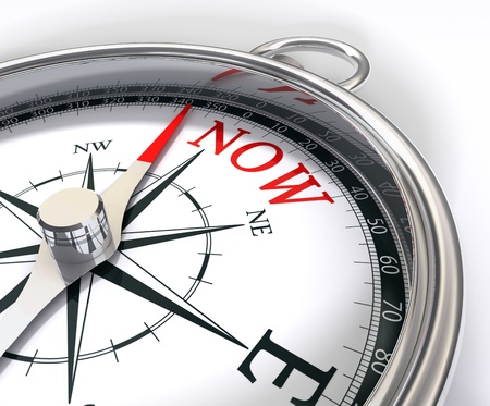 going for the present for now conceptual image with a compass that has instead of north word now a metaphor catch the day Stock Photo