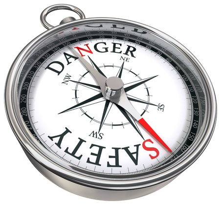 danger vs safety opposite ways conceptual image with compass isolated on white background photo