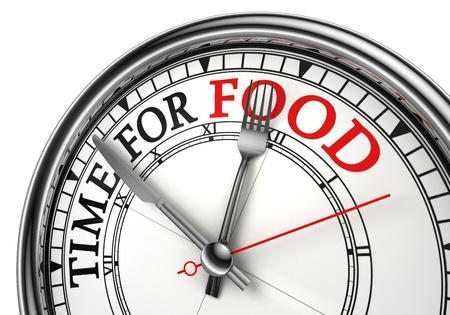 time for food concept clock closeup on white background with red and black words photo