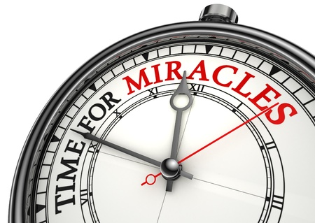 miracles: time for miracles concept clock closeup on white background with red and black words