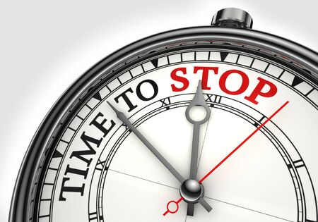 cease: time to stop concept clock closeup on white background with red and black words Stock Photo